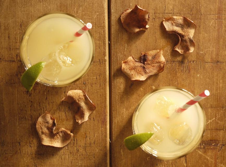 Spiced apple cocktail with cinnamon apple crisps